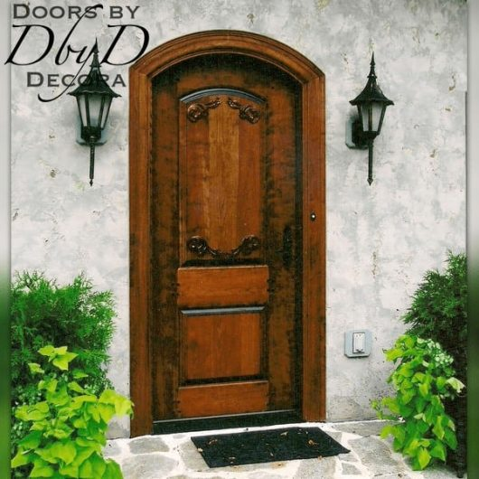 A custom estate door with applied carvings on the panel.