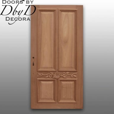 An unfinished custom door featuring a custom applied carving.