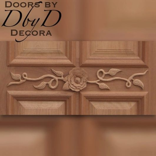 A close-up view of the custom applied carving on this custom door.