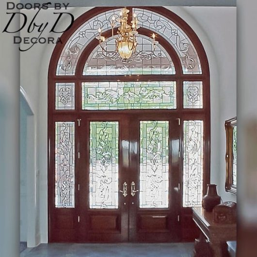 An interior view of a grand entrance to showcase the beautiful leaded glass.