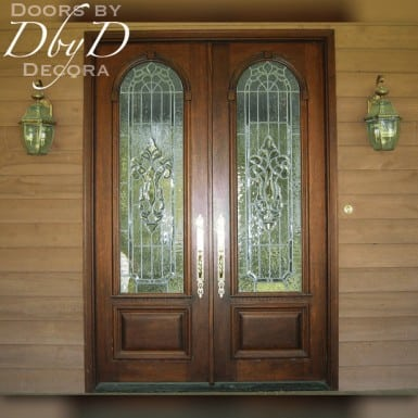 A pair of double doors featuring leaded beveled and textured glass.