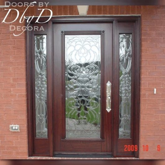 An exterior view of a full lite door and side lites with leaded beveled glass.