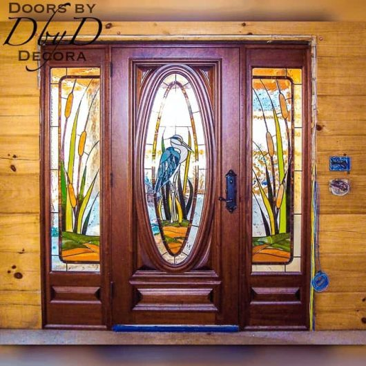 Our signature oval door with custom stained glass designed and built by Doors by Decora.
