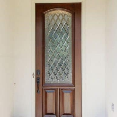 A single eight foot tall door with leaded glass.