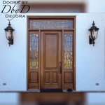 An eight foot tall door with leaded glass side lites and transom.