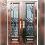 A pair of double doors featuring leaded beveled glass.