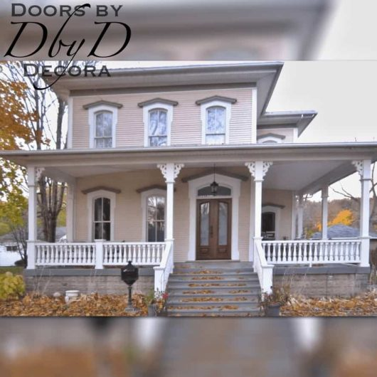 A victorian style home featuring custom double doors.