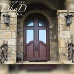 These double doors feature a rabbited transom giving the impression that they are much taller.