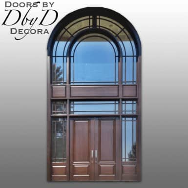 A very tall and elegant front entry custom built by Doors by Decora.