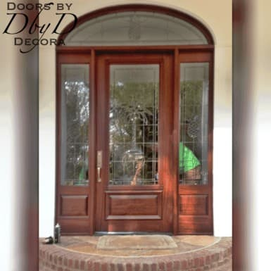 A unique door, side lites, and transom with custom pineapple beveled glass.