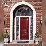 A traditional estate style door with leaded glass in the side lites and transom.