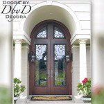 Custom wrought iron grills can be found on the doors and transom of this country french opening.