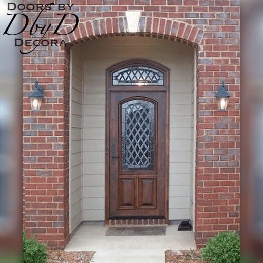 This beautiful country french unit features leaded glass in the door and transom.