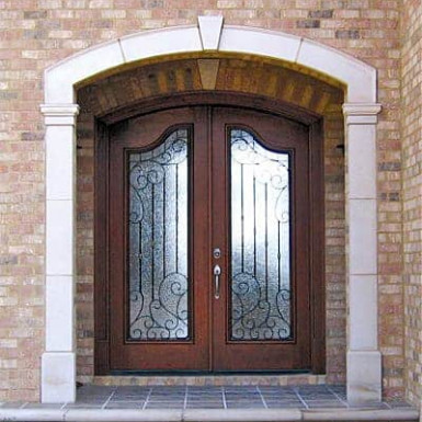 Country french doors featuring custom wrought iron grills.