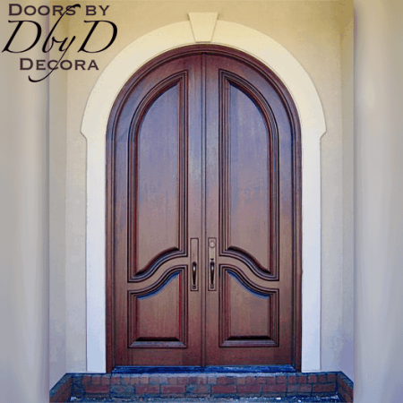 A beautiful pair of solid country french radius top doors.