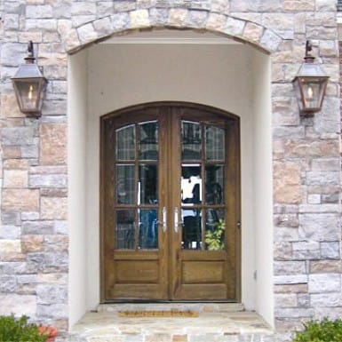 A pair of country french doors featuring beveled glass.