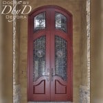 A large country french style entrance featuring leaded rondel glass and custom wrought iron grills.