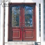 This pair of country french style doors features custom wrought iron grills.