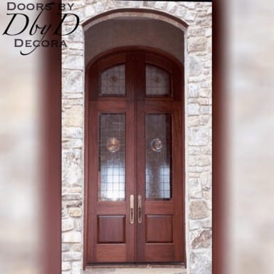 This pair of country french doors feature a rabbited transom and rondel leaded glass.