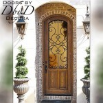 A country french door with a custom piece of wrought iron.
