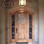 A country french speakeasy door featuring rondel leaded glass.