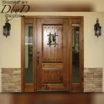 A country french door with a speakeasy and wrought iron.