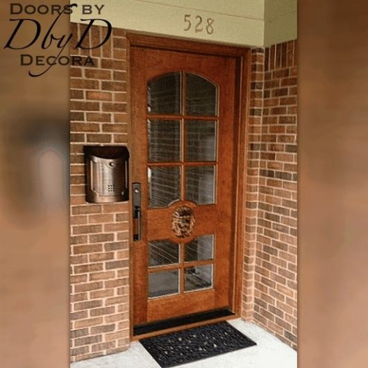 This single lion head door features beveled glass and an applied carved lion head.
