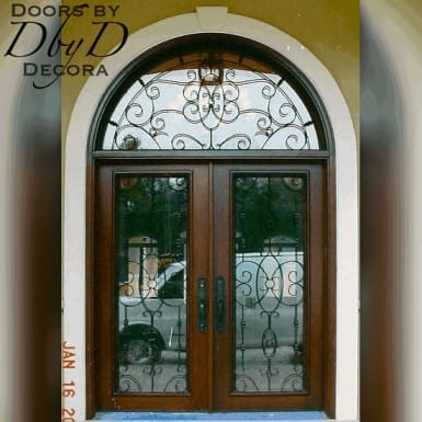 These country french doors feature custom designed wrought iron grills.