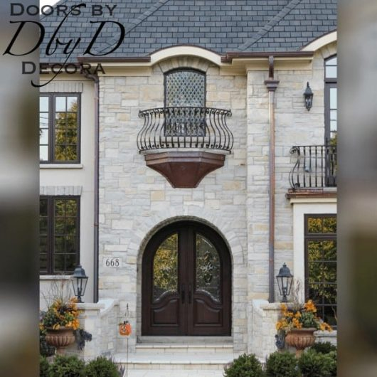 A shot of a beautiful country french home with custom doors designed and built by Doors by Decora.