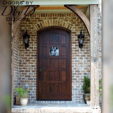 This unique country french door features a custom leaded glass window.