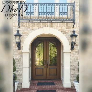 These beautiful country french doors feature custom designed wrought iron grills.