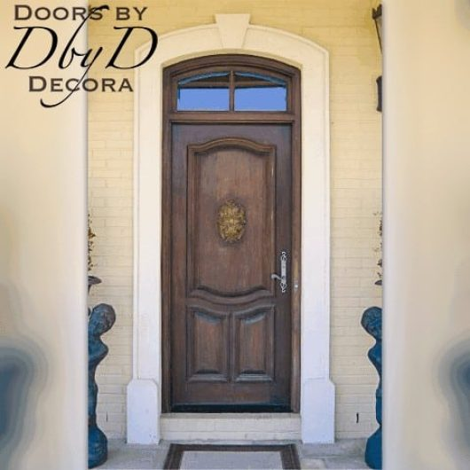 A country french door with an applied carving on the center panel.