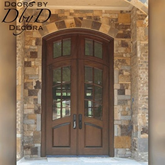 A beautiful pair of country french doors with a matching transom.