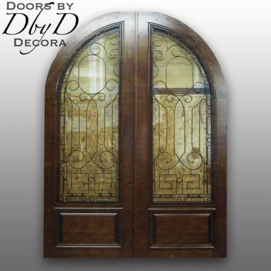 These double radius top doors have been hand distressed and feature custom wrought iron grills.
