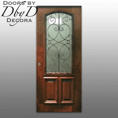 A single country french door with a custom wrought iron grill.