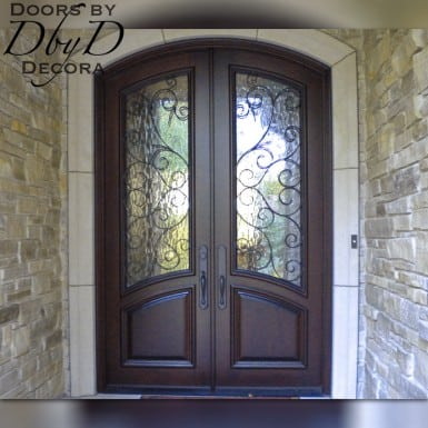 A pair of double country french doors with custom wrought iron grills.