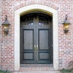 A beautiful pair of old world style doors featuring a unique true divided lite transom.