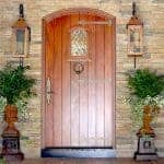 An old world style plank door with decorative strap hinges.