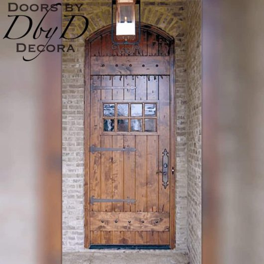 A hand distressed old world style door.