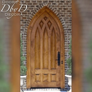 A beautiful old world style door with a gothic arch and panel configuration.