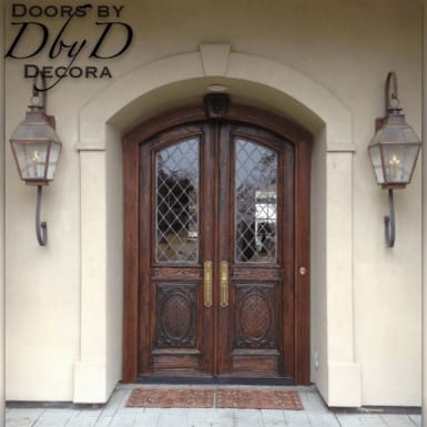 A pair of old world style doors with custom carved panels.