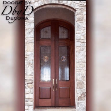 These double doors feature rondels in their leaded glass.