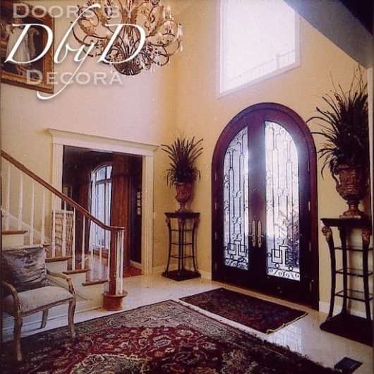 This is a pair of common radius top double doors with custom wrought iron grills.