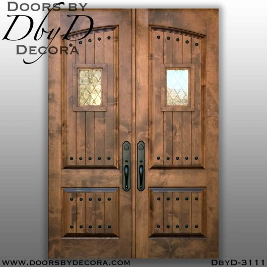 old world arched panel double doors