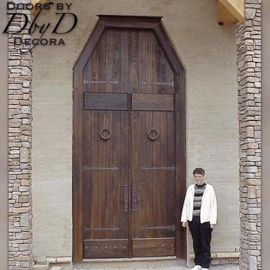 These double doors feature a rabbited transom to give the illusion that they are even taller than they are.