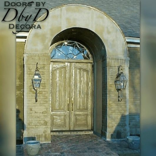 These double doors have been distressed to add to their old world look.