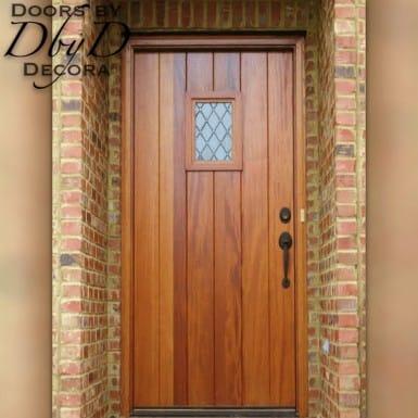 An old world plank door with a speakeasy door.