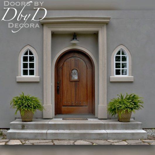 An extra wide radius top door with a speakeasy door.