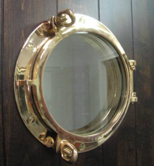 A close-up look at the porthole hardware featured in this door.