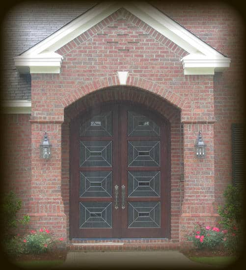 The clean lines in the leaded glass in these eight foot tall double doors give them a modern feel.